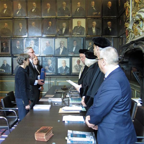 Dr. Frank E. Blokland receiving his diploma
